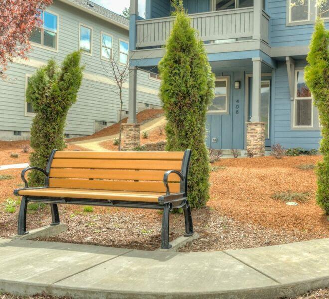 Bench on a sidewalk in the Billings Ranch community of Ashland, Oregon