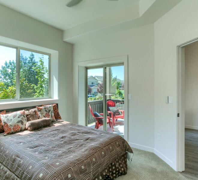 Bedroom of a home at Meadowbrook Park Condos in Ashland Oregon